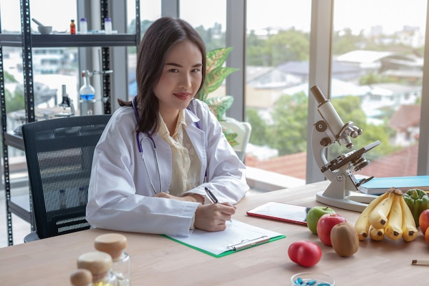 Portraits of female doctors recording on the table