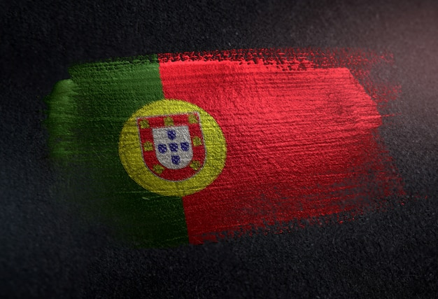 Portugal flag made of metallic brush paint on grunge dark wall