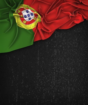 Portugal flag vintage on a grunge black chalkboard with space for text