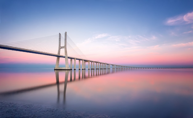 Portugal, lisbon - vasco da gama bridge in lisbon at sunset. europe. long exposure photography