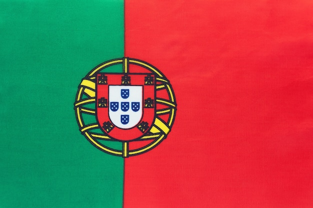 Portugal national fabric flag, textile background. symbol of international world european country.