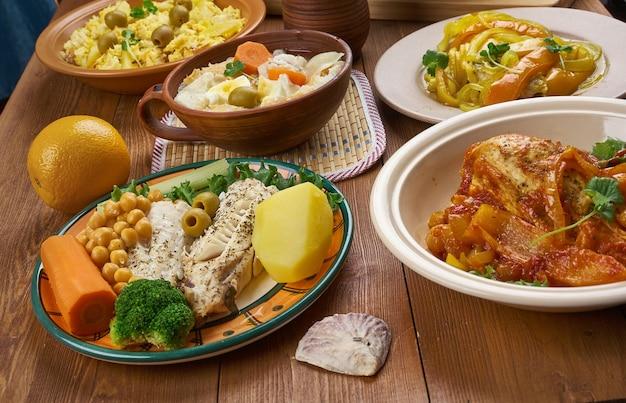 Португальская кухня - традиционные ассорти из блюд португалии, вид сверху.