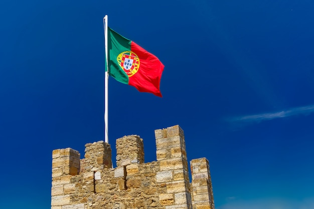 Portuguese flag on fortress wall, lisbon, portugal