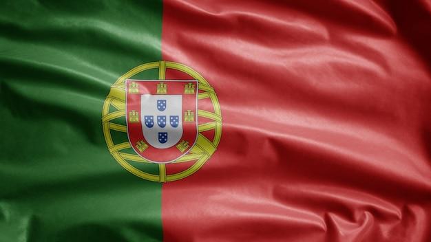 風に揺れるポルトガルの旗。ポルトガルのテンプレートを吹く、柔らかく滑らかなシルクのクローズアップ。布生地のテクスチャは、背景をエンサインします。