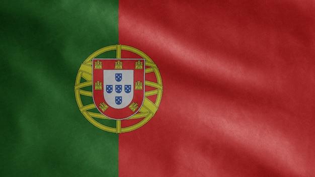 風に揺れるポルトガルの旗。ポルトガルのテンプレートを吹く、柔らかく滑らかなシルクのクローズアップ。