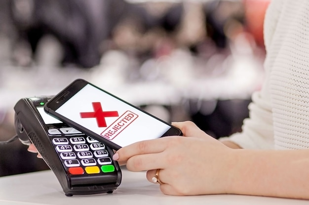 Pos terminal, payment machine with mobile phone on store. contactless payment with nfc technology.