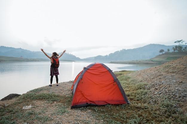 Pose caucasian woman rise arm near a tent