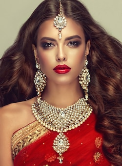 Posh jewelry set is consisting of big earrings, bright necklace and head adornment (tikka). perfect, dense, wavy, freely flying hair and