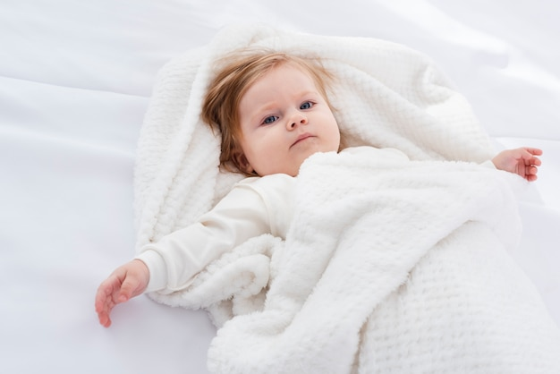 Posing baby in blanket