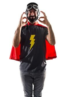 Posing crazy funny cape superhero