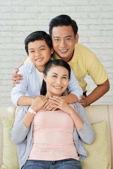 Posing for photography with loving parents
