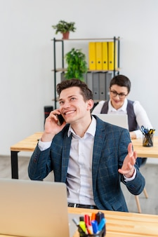 Positive adult male talking on the phone