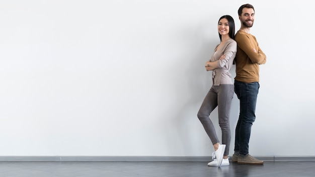 Positive adult male and woman posing with copy space