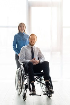 Positive adult man and woman posing