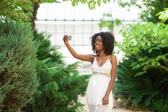 Positive Black Woman Taking Selfie Photo in Park