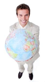 Positive businessman showing a terrestrial globe