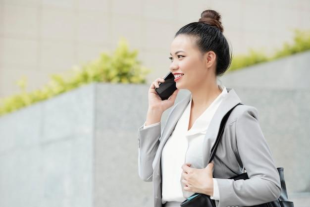 Positive calling businesswoman