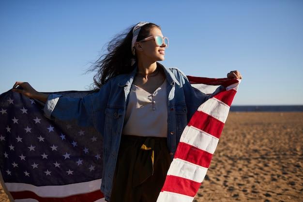 Positive carefree american girl on beach