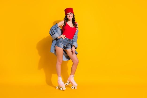 Positive charming girlish youth teen student girl roller skater
