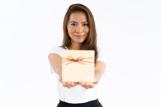 Positive cheerful girl giving gift