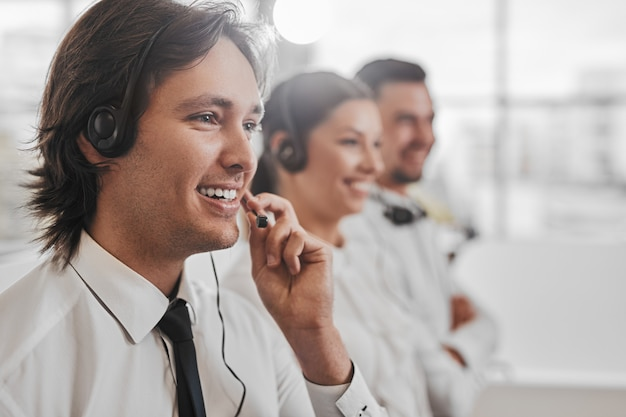 Positive colleagues working in call center