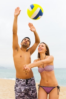 Positive couple on the shore Premium Photo