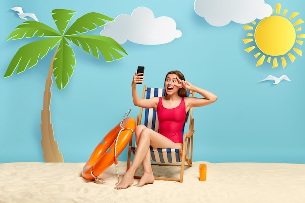 Positive european woman relaxes in deck chair