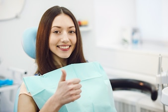 Positive girl at the dentist