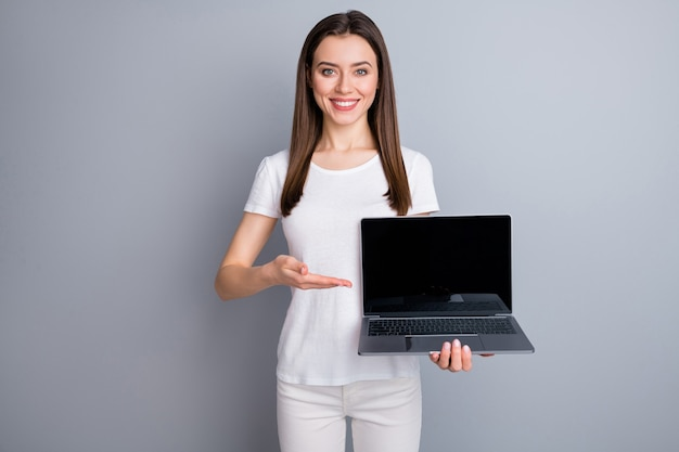 Positive girl promoter hold laptop point hand touchscreen recommend device