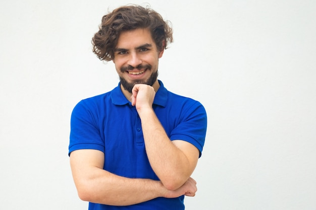 Positive happy guy leaning chin on hand