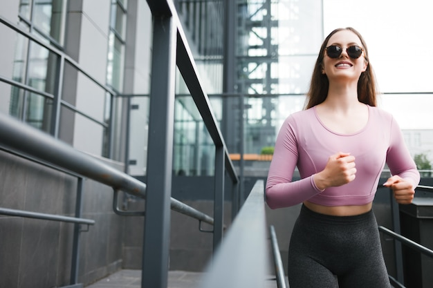 Positive jogging girl in the city