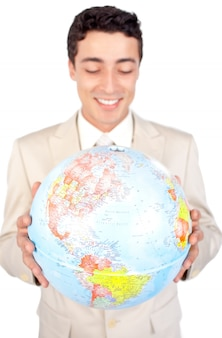 Positive male executive looking at a globe