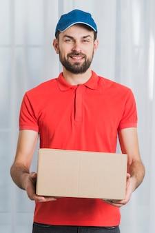 Positive man delivering parcel