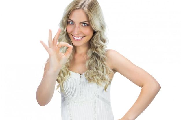 Positive seductive model in white dress waving