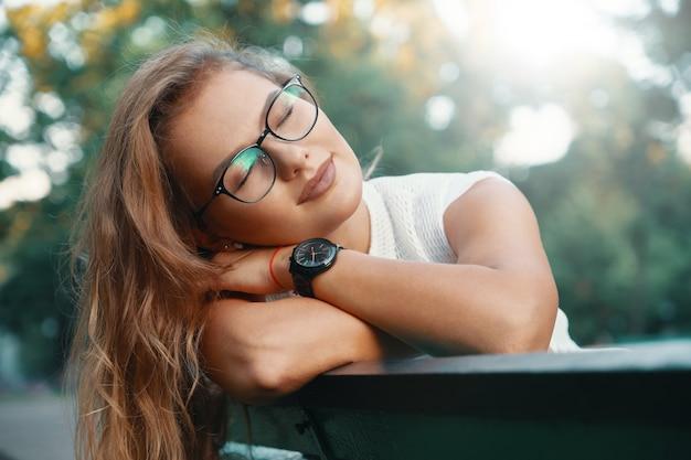 Positive woman having a break from city noise