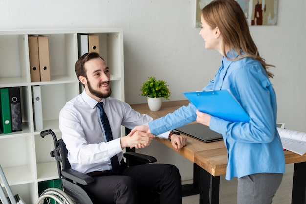 Positive woman and man shaking hands together