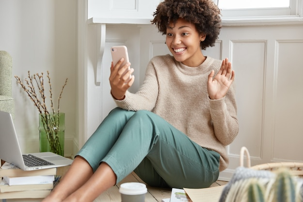 Positive woman working at home