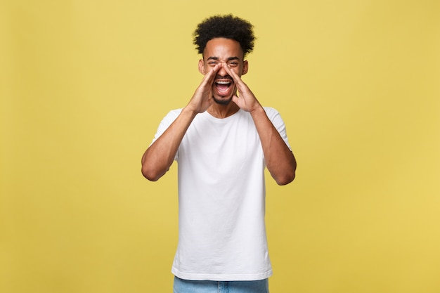 Positive young black guy, student, worker employee screams mouth wide open