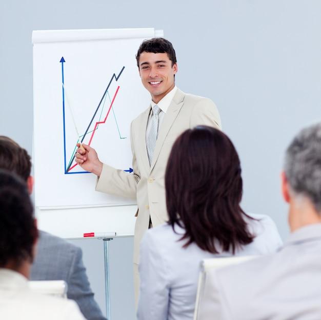 Positive young businessman doing a presentation