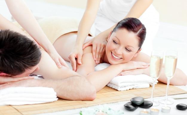 Positive young couple enjoying a back massage