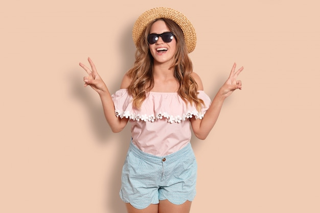 Positive young female tourist with joyful expression