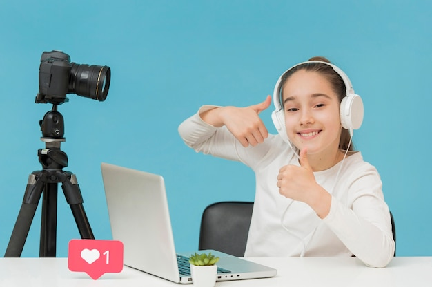 Positive young girl happy to record for personal blog