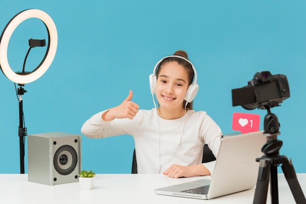 Positive young girl happy to record video