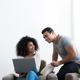 Positive young man and woman working together