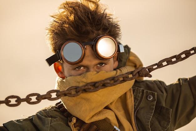 Post-apocalyptic cyberpunk boy outdoors. closeup portrait. nuclear post-apocalypse time. life