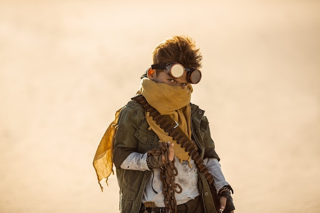 Post-apocalyptic cyberpunk boy outdoors. nuclear post-apocalypse time. life after doomsday