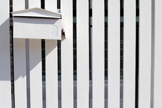 Post box in white wooden fence