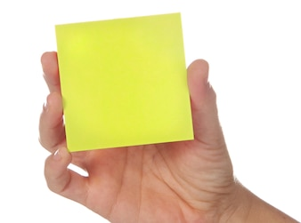 Post-It and hand  a over white background
