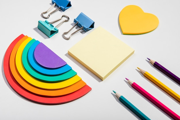 Post-it note cards and school tools and rainbow paper high view