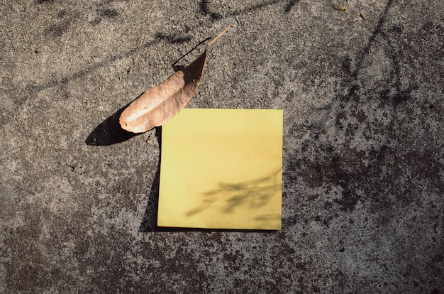 Post it note on an old background
